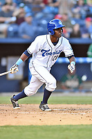 Asheville Tourists center fielder Shael Mendoza (21) swings at a pitch during a game against the Greensboro Grasshoppers at McCormick Field on May 10, 2018 in Asheville, North Carolina. The Tourists defeated the Grasshoppers 14-10. (Tony Farlow/Four Seam Images)