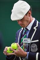 England, London, 28.06.2014. Tennis, Wimbledon, AELTC, Linesman checking the new balls<br /> Photo: Tennisimages/Henk Koster