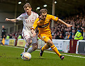 Motherwell's Nicky Law gets away from Don's Jonny Hayes.