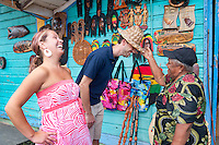 Montego Bay, Jamaica. Newlywed couple shopping for souveniers in local market. Jamaica Tourism.