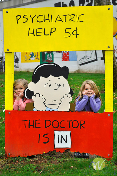 Cartoon character Lucy with psychiatric help stand.