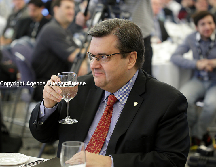 Minister Pierre Arcand (L) and Montreal Mayor Denis Coderre (R)  at Montreal car show. January 15, 2016<br /> <br /> Photo : Pierre Roussel - Agence Quebec Presse<br /> <br /> <br /> <br /> <br /> <br /> <br /> <br /> <br /> <br /> <br /> <br /> .