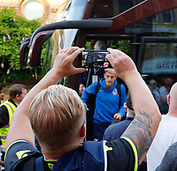 A Bristol Rovers FC fan takes a photo of the team arriving prior to the Carabao Cup match between Fulham and Bristol Rovers at Craven Cottage, London, England on 22 August 2017. Photo by Carlton Myrie.