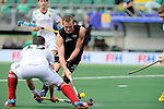 The Hague, Netherlands, June 08: Hugo Inglis #29 of New Zealand dribbles the ball during the field hockey group match (Men - Group B) between the Black Sticks of New Zealand and Germany on June 8, 2014 during the World Cup 2014 at Kyocera Stadium in The Hague, Netherlands. Final score 3-5 (1-3) (Photo by Dirk Markgraf / www.265-images.com) *** Local caption ***