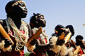 Banjul, The Gambia. Welcome dance at Banjul airport; women playing claves and singing.