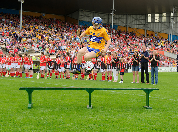 Clare's Podge Collins jumps the bench before the Senior hurling championship semi-final at Thurles. Photograph by John Kelly.