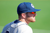 Dan Godefroi #24 of the Georgetown Hoyas watches the action from the dugout during the game against the Delaware State Hornets at Gene Hooks Field on February 26, 2011 in Winston-Salem, North Carolina.  Photo by Brian Westerholt / Four Seam Images