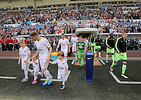 Angel Rangel with his children comes out of the tunnel before kick off at the Swansea City FC v Manchester City Premier League game at the Liberty Stadium, Swansea, Wales, UK, Sunday 15 May 2016