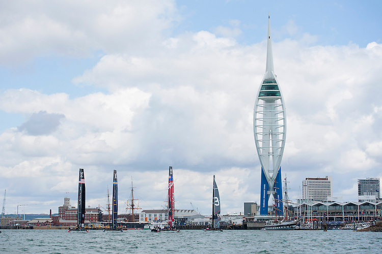25 July 2015: The parade of sails goes past the Spinnaker Tower before the America's Cup first round racing off Portsmouth, England (Photo by Rob Munro)