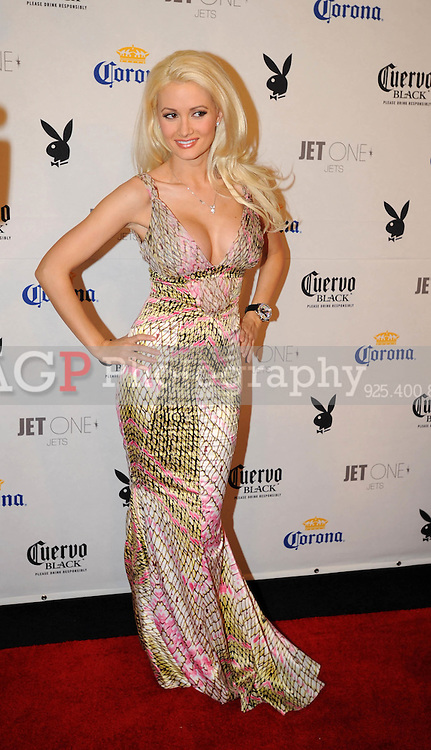 """Holly Madison, star of Playboy's """"Girls Next Door"""" poses on the red carpet at Playboy's ninth annual """"Super Saturday Night""""  party in at Playboy's Desert Oasis and Resort in Chandler, Arizona Saturday February 2, 2008.   (Photo by Alan Greth)"""