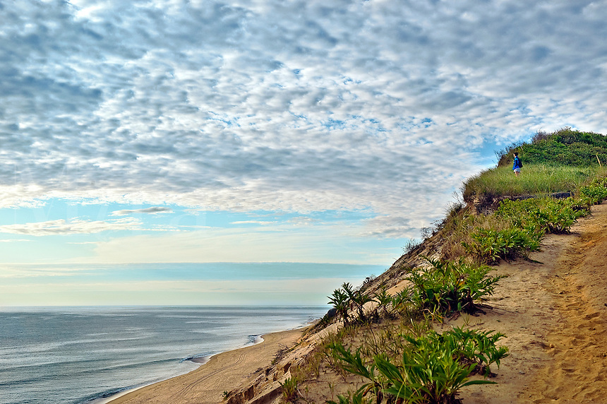 Woman enjoys the scenic view from the dune cliffs overlooking Cape Cod National Seashore, Long Nook Beach, Truro, Cape Cod, MA, USA