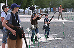 Teens practice at the Capital City Gun Club, in Carson City, Nev., on Friday, July 11, 2014.<br />
