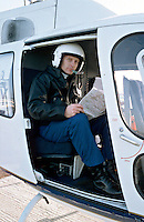 Police officers of the air support unit sitting in the cockpit of the police helicopter.  ..© SHOUT. THIS PICTURE MUST ONLY BE USED TO ILLUSTRATE THE EMERGENCY SERVICES IN A POSITIVE MANNER. CONTACT JOHN CALLAN. Exact date unknown.john@shoutpictures.com.www.shoutpictures.com...