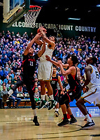 16 December 2018: University of Vermont Catamount Forward Anthony Lamb, a Junior from Toronto, Ontario, is fouled on a layup in first half action against the Northeastern University Huskies at Patrick Gymnasium in Burlington, Vermont. The Catamounts defeated the Huskies 75-70 in NCAA Division I America East play. Mandatory Credit: Ed Wolfstein Photo *** RAW (NEF) Image File Available ***