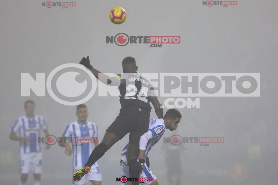 CD Leganes' Youssef En-Nesyri and Sevilla FC's Joris Gnagnon during La Liga match between CD Leganes and Sevilla FC at Butarque Stadium in Leganes, Spain. December 23, 2018. (ALTERPHOTOS/A. Perez Meca) /NortEPhoto.com