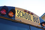 Close-up of school bus sign on bus.