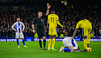 Wilfried Zaha of Crystal Palace is shown the yellow card for a foul on Solly March of Brighton & Hove Albion (20)  ,during the Premier League match between Brighton and Hove Albion and Crystal Palace at the American Express Community Stadium, Brighton and Hove, England on 4 December 2018. Photo by Edward Thomas / PRiME Media Images.