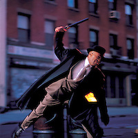 Man in suit swinging nightstick