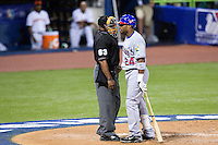 10 March 2009: #24 Robinson Cano of the Dominican Republic talks to homeplate umpire Laz Diaz during the 2009 World Baseball Classic Pool D game 5 at Hiram Bithorn Stadium in San Juan, Puerto Rico. The Netherlands pulled off second upset to advance to the secound round. The Netherlands come from behind in the bottom of the 11th inning and beat the Dominican Republic, 2-1.