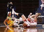 SIOUX FALLS, SD - MARCH 8: Jeniah Ugofsky #30 of the South Dakota Coyotes controls a loose ball against the North Dakota State Bison during the Summit League Basketball Tournament at the Sanford Pentagon in Sioux Falls, SD. (Photo by Richard Carlson/Inertia)