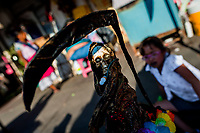 A statue of Santa Muerte (Holy Death), holding a large scythe, is seen placed on the street during a religious pilgrimage in Tepito, Mexico City, Mexico, 1 April 2018. The religious cult of Santa Muerte is a fusion of Aztec death worship rituals and Catholic beliefs. Born in lower-class neighborhoods of Mexico City, it has always been closely associated with crime. In the past decades, original Santa Muerte followers, such as prostitutes, pickpockets and street drug traffickers, have merged with thousands of ordinary Mexican Catholics. The Holy Death veneration, offering a spiritual way out of hardship in modern society, rapidly expanded. Although the Catholic Church still considers Santa Muerte followers the devil worshippers, on the first day of every month, crowds of Santa Muerte believers fill the streets of Tepito. Holding statues of Holy Death clothed in a long robe, they pray for healing, protection, money or any other favor in life.