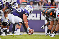 TCU center Joey Hunt (55) set to snap the ball on the line of scrimmage during second half of an NCAA football game, Saturday, October 18, 2014 in Fort Worth, Tex. TCU defeated Oklahoma State 42-9. (Mo Khursheed/TFV Media via AP Images)