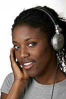 2005, Montreal Qc) CANADA<br /> Model Released photo<br /> a black woman listen to music on a pair of headphones<br /> Photo : (c) 2005 Pierre Roussel