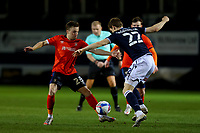 23rd February 2021; Kenilworth Road, Luton, Bedfordshire, England; English Football League Championship Football, Luton Town versus Millwall; Joe Morrell of Luton Town is challenged by Jón Daoi Boovarsson of Millwall