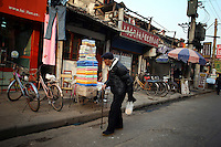CHINA. Shanghai. An elderly man in the old town. Shanghai is a sprawling metropolis or 15 million people situated in south-east China. It is regarded as the country's showcase in development and modernity in modern China. This rapid development and modernization, never seen before on such a scale has however spawned countless environmental and social problems. 2008.
