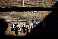 Clothes hang drying in a migrant worker village south of Beijing.