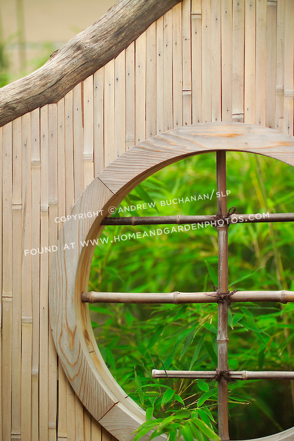 closeup detail of a well-crafted circular hole or window in a bamboo gate or fence, with soft focus bamboo growing in the background