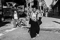 People walking in Roosevelt Avenue. Jackson Heights, Queens, New York.