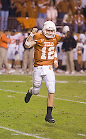 04 November 2006: Texas quarterback Colt McCoy (#12) celebrates after a touchdown reception during the Longhorns 36-10 victory over the Oklahoma State University Cowboys at Darrel K Royal Memorial Stadium in Austin, Texas.  McCoy passed for 346 yards on the night and broke the school record for touchdown passes in a single season, 27.