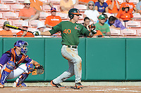 Catcher Garrett Kennedy #40 swings at a pitch during a  game against the Clemson Tigers at Doug Kingsmore Stadium on March 31, 2012 in Clemson, South Carolina. The Tigers won the game 3-1. (Tony Farlow/Four Seam Images).