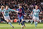 Lionel Messi of FC Barcelona (C) dribbles Andreu Fontas Prat of RC Celta de Vigo (L) during the La Liga 2017-18 match between FC Barcelona and RC Celta de Vigo at Camp Nou Stadium on 02 December 2017 in Barcelona, Spain. Photo by Vicens Gimenez / Power Sport Images