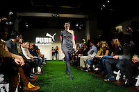 A model wearing an outfit by fashion designer Christian Siriano walks the runway during the unveiling of the Women's Professional Soccer uniforms at the Event Place in Manhattan, NY, on February 24, 2009. Photo by Howard C. Smith/isiphotos.com