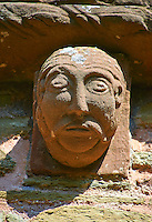Norman Romanesque exterior corbel no 82 - sculpture of mans head with a moustache and beard similar to no 79. The Norman Romanesque Church of St Mary and St David, Kilpeck Herefordshire, England. Built around 1140