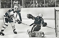 1979 FILE PHOTO - ARCHIVES -<br /> <br /> Touches: Toronto winger Tiger Williams tucks tap-in past Buffalo goaltender Don Edwards in the second period last night at Maple Leaf Gardens to get the Leafs on the scoresheet after Sabres had taken a four-goal lead. It was the first of a brace of goals for the usually tempestuous Tiger who earned the second of three stars awarded despite the fact the Leafs continued their slide with another loss, this time 4-3. A two-goal rally in the final period couldn't be overcome.<br /> <br /> Bezant, Graham<br /> Picture, 1979<br /> <br /> 1979,<br /> <br /> PHOTO : Graham Bezant - Toronto Star Archives - AQP