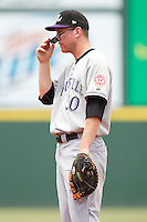 First baseman Todd Frazier #50 of the Louisville Bats adjusts his sunglasses during the game against the Charlotte Knights at Knights Stadium on July 17, 2011 in Fort Mill, South Carolina.  The Knights defeated the Bats 7-6.   (Brian Westerholt / Four Seam Images)