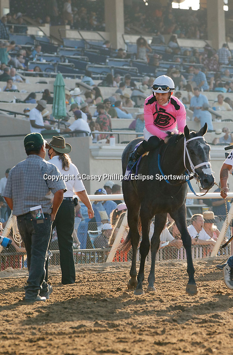 DEL MAR, CA  SEPTEMBER 5: #10 Liam's Dove, ridden by Kyle Frey,  receives congratulations from assistant trainer Ruben Alvarado after winning the Del Mar Juvenile Fillies Turf on September 5, 2021 at Del Mar Thoroughbred Club in Del Mar, CA. (Photo by Casey Phillips/Eclipse Sportswire/CSM)