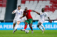 14th November 2020, The Estádio da Luz, Lisbon, Portugal; Nations League International football, Portugal versus France; Danilo Pereira of Portugal is challenged by Adrien Rabiot and N'Golo Kanté of France