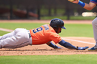 Houston Astros Pedro Leon (9) dives back to the bag on a pickoff attempt during a Minor League Spring Training game against the New York Mets on April 27, 2021 at FITTEAM Ballpark of the Palm Beaches in Palm Beach, Fla.  (Mike Janes/Four Seam Images)