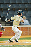 Evan Stephens (5) of the Wake Forest Demon Deacons follows through on his swing against the North Carolina State Wolfpack at Wake Forest Baseball Park on March 15, 2013 in Winston-Salem, North Carolina.  The Wolfpack defeated the Demon Deacons 12-6.  (Brian Westerholt/Four Seam Images)