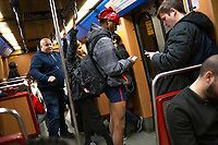LISBON - PORTUGAL 12: Participants of the No Pants Subway Ride ride a train on January 12, 2020 in Lisbon, Portugal. The annual event, in which participants board a subway car in January while not wearing any pants while behaving as though they do not know each other, began as a joke by the public prank group Improv Everywhere in New York City and has since spread around the world, with enthusiasts in around 60 cities and 29 countries across the globe, according to the organization's site. <br /> (Photo by Luis Boza/VIEWpress)