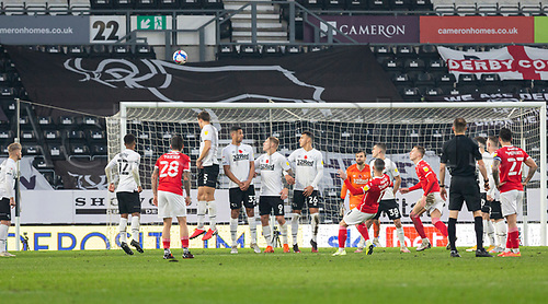 7th November 2020; Pride Park, Derby, East Midlands; English Football League Championship Football, Derby County versus Barnsley; Conor Chaplin of Barnsley takes a free kick over the Derby defence but goes over the bar and out of play