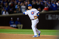 Chicago Cubs shortstop Addison Russell (27) throws to first base in the fifth inning during Game 5 of the Major League Baseball World Series against the Cleveland Indians on October 30, 2016 at Wrigley Field in Chicago, Illinois.  (Mike Janes/Four Seam Images)
