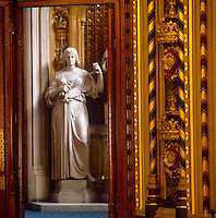 Figure of Justice by John Gibson, part of a group with Queen Victoria and Mercy, is glimpsed through the sumptuously decorated doorway from the Royal Gallery