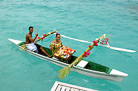 Resort staff delivering breakfast via an outrigger canoe.Bora Bora Nui Resort & Spa,.a member of Starwood's Luxury Collection.Bora Bora, French Polynesia.October 12, 2007.©2007 Kathy Hutchins / Hutchins Photo..EXCLUSIVE..please credit photographer and resort in all usage....