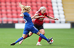 Alex Greenwood of Manchester United Women is caught by Ellie Christan of Durham