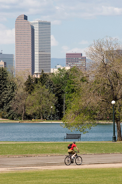 Man cycling in City Park, Denver, Colorado, .  John offers private photo tours in Denver, Boulder and throughout Colorado. Year-round.